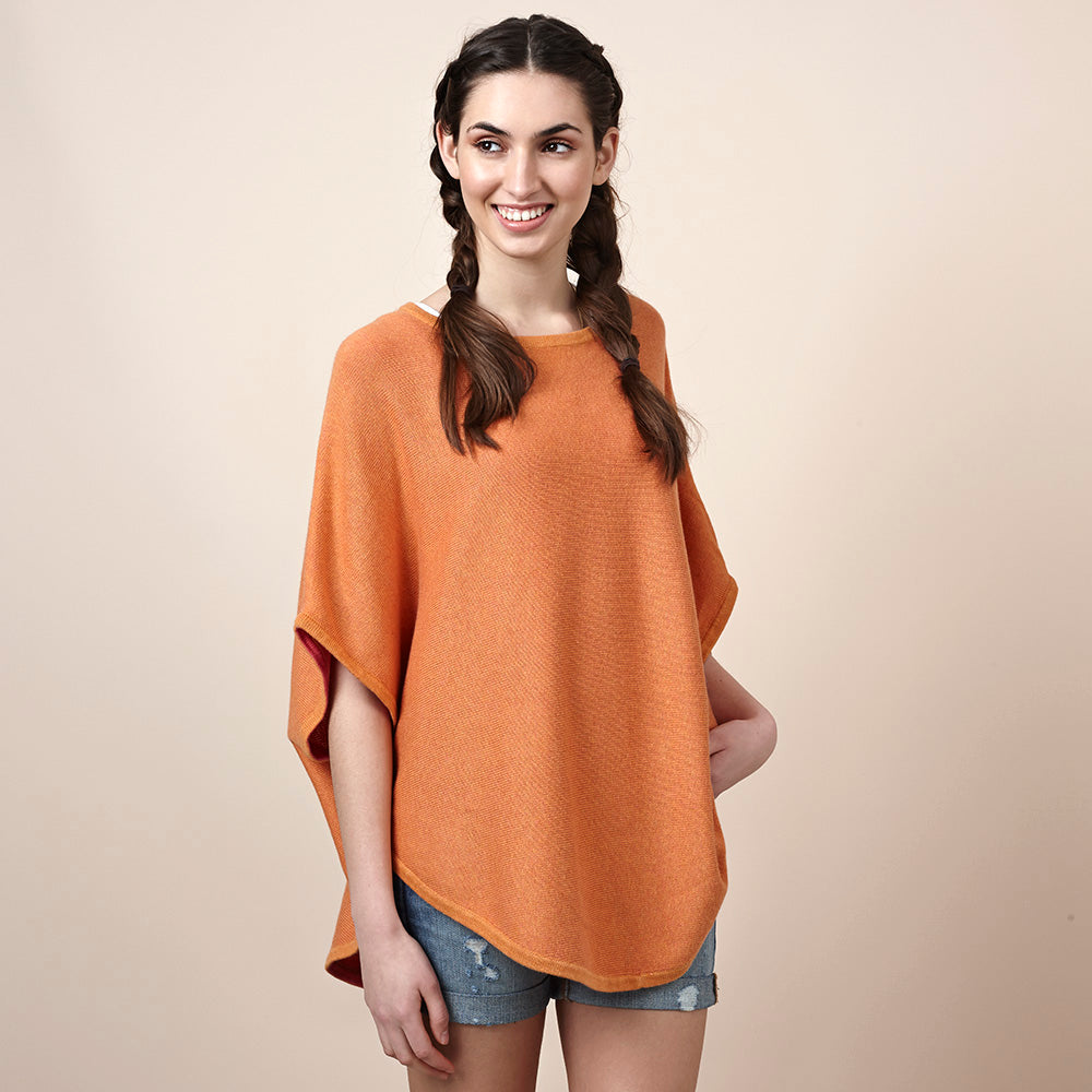 flora reversible poncho citrus and coral