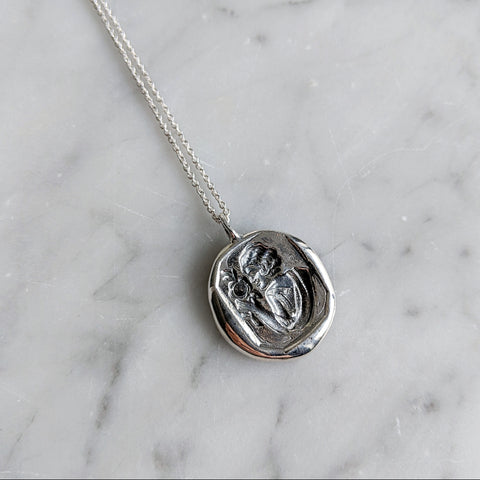 I Change Only In Death Wax Seal Necklace