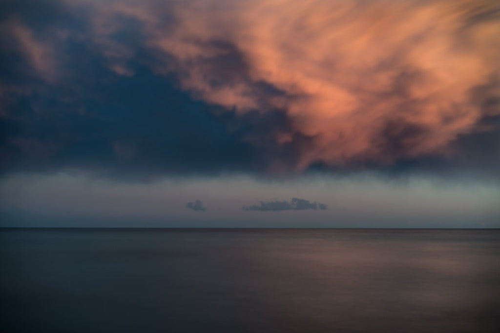 Dramatic cloudscape sunset over the Mediterranean sea at dusk