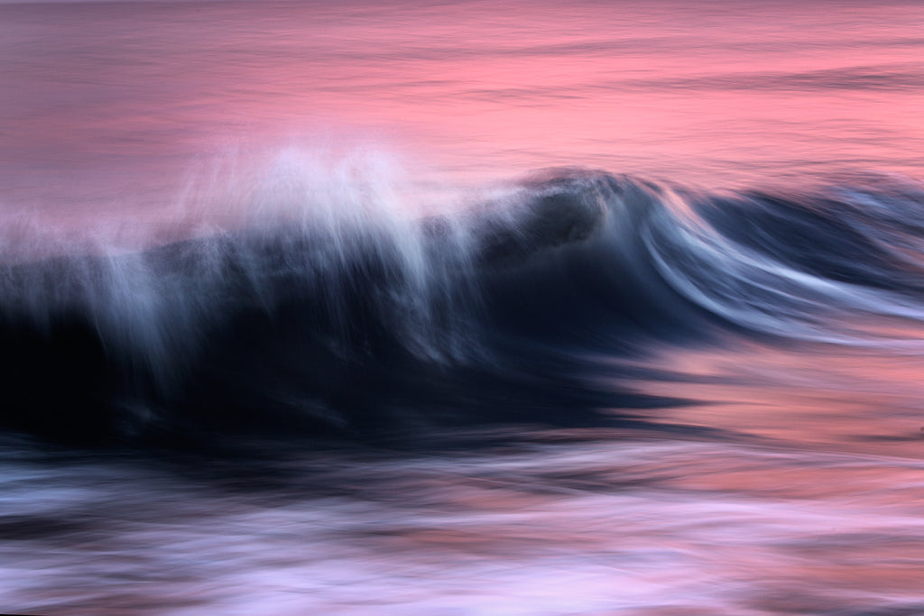 Vibrant abstract photography of dusk lighting up the  Mediterranean sea with a soothing pink light