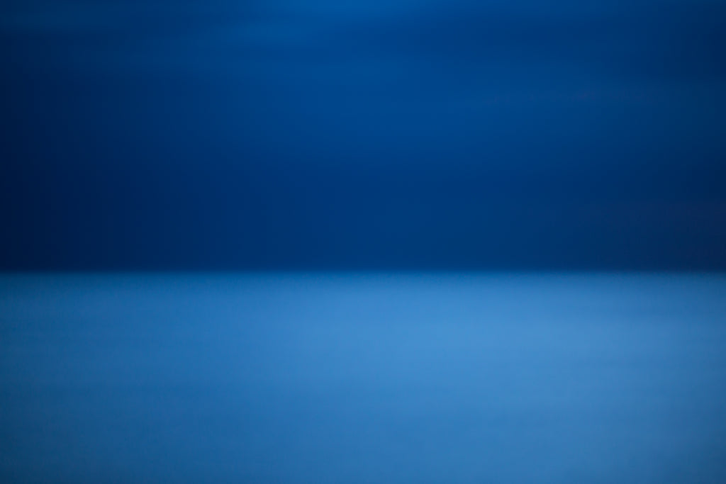 Gorgeous blue Rothko like abstract artwork of dawn light over the Mediterranean sea Italy