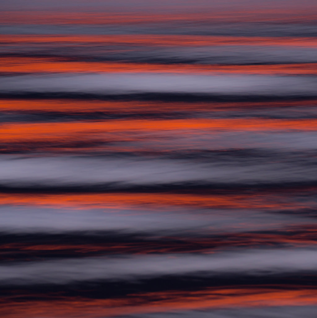 Gorgeous impressionist abstract artwork alternating waves in lines of vibrant orange and a dusky blue grey.