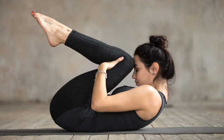 sporty woman doing yoga asanas