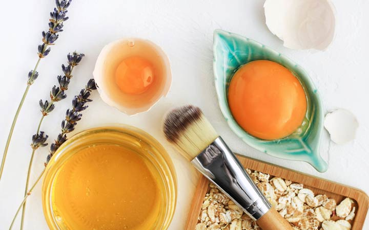 Bright egg yolks, oatflakes, honey, lavender with cosmetic brush