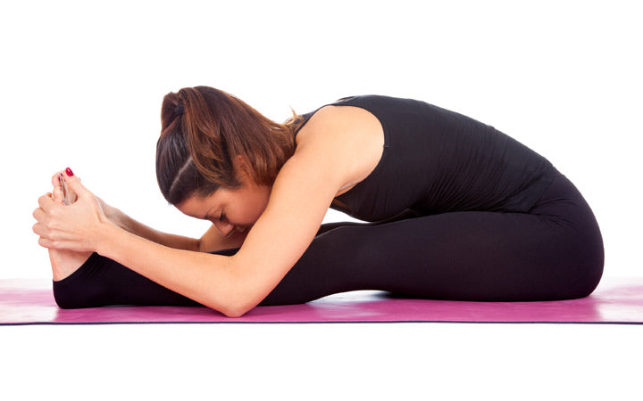 woman doing paschimottanasana