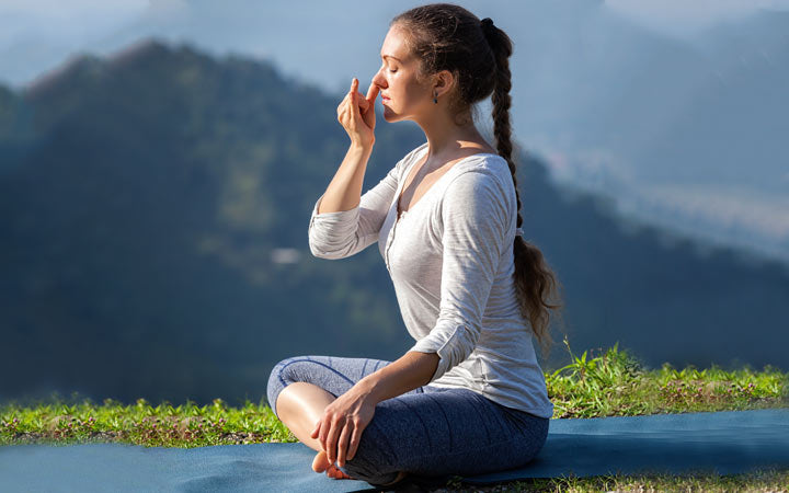 woman practices pranayama yoga breath