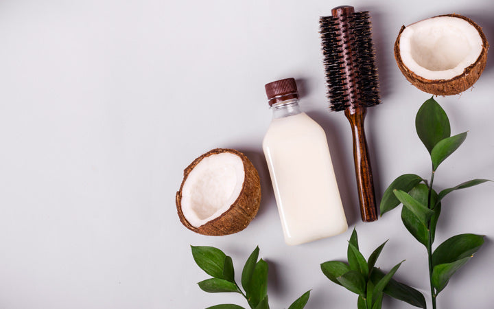 coconut oil and tropical leaves