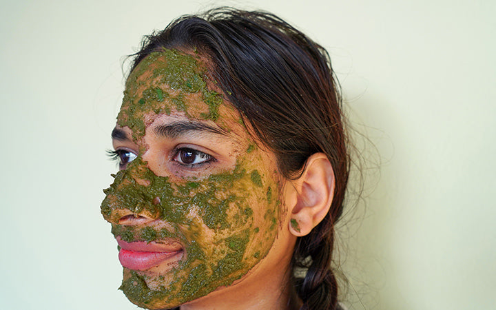 girl with green ayurvedic face pack