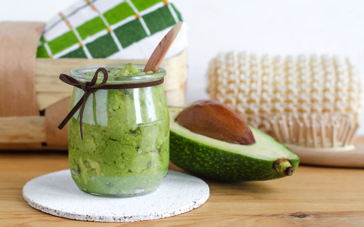 homemade avocado mask in a glass jar
