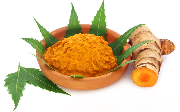 medicinal turmeric paste with neem leaves