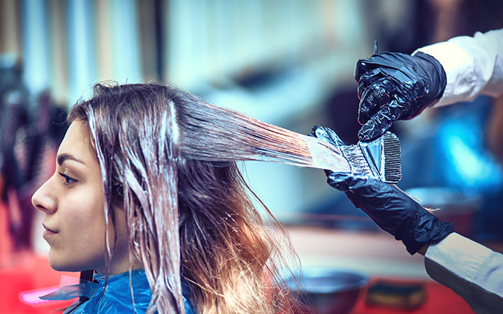 professional hairdresser dyeing hair