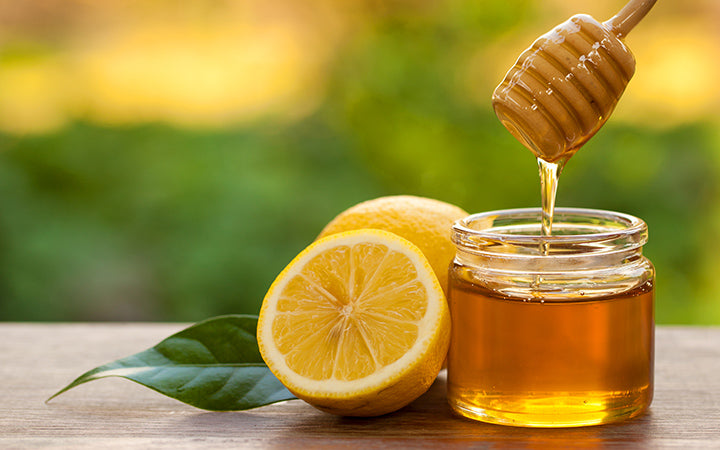 pure honey and lemon slices for skin and face bleaching
