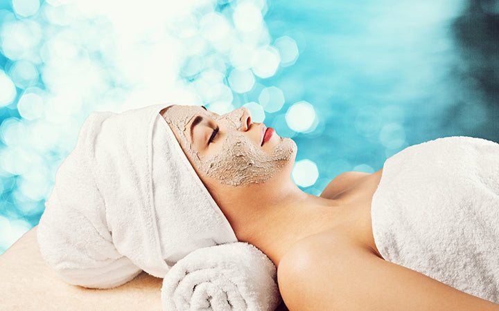 relaxing woman with face pack