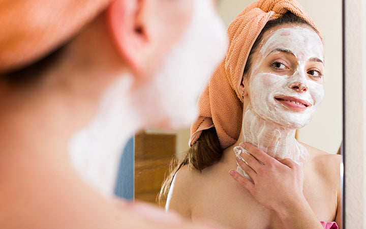 woman applying face pack