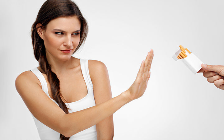 woman refusing to take cigarette from pack