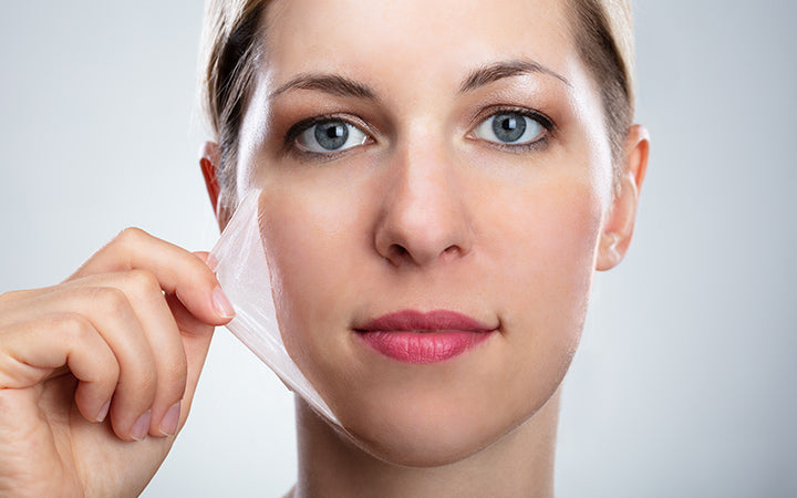 woman removing peeling mask from her face