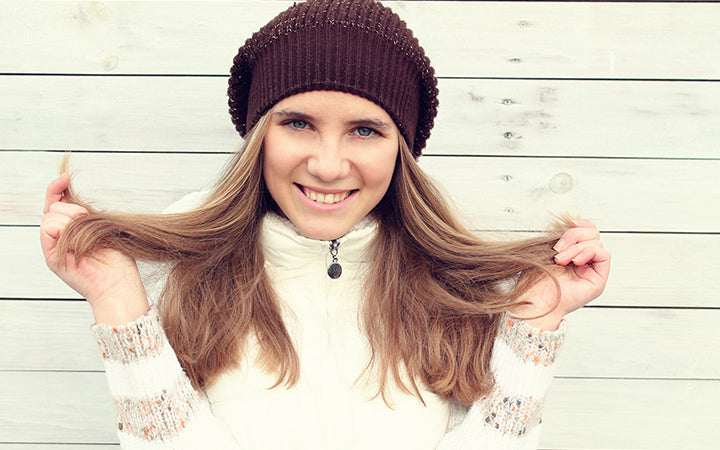woman showing healthy hair in winter