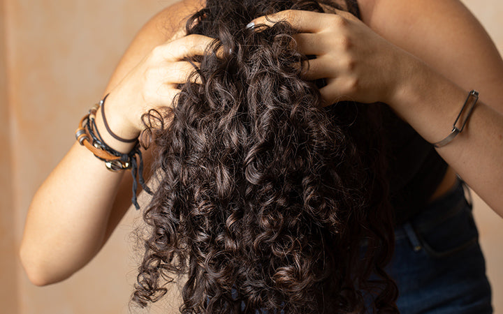 woman showing long curly hair