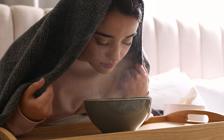 woman steaming her face at home