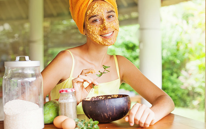 woman using natural ingredients as face mask for skin care