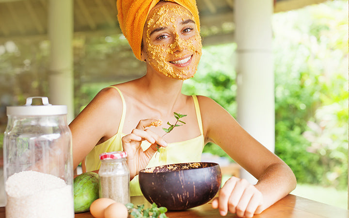 woman using natural secrets to do a skin care