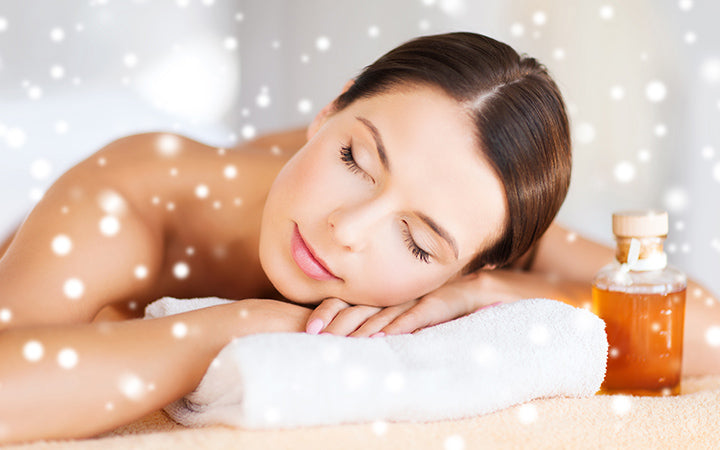 woman with body oil in spa