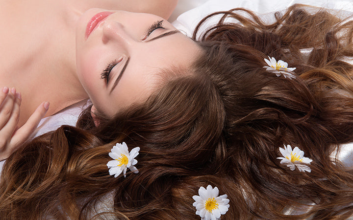woman with camomile flowers in her hair