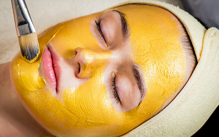 woman with facial mask treatment
