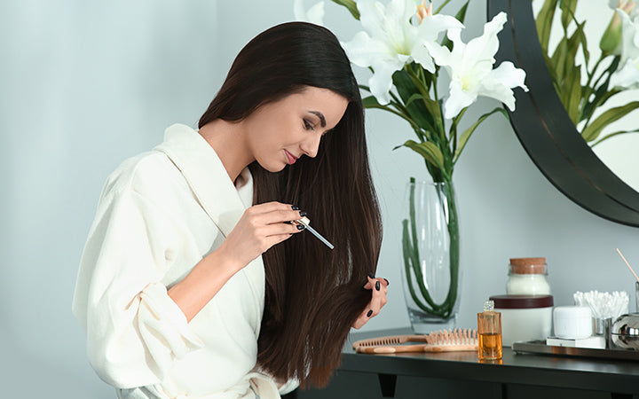 young woman applying serum