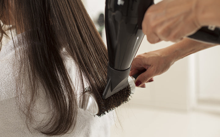 young woman hair salon drying shaping