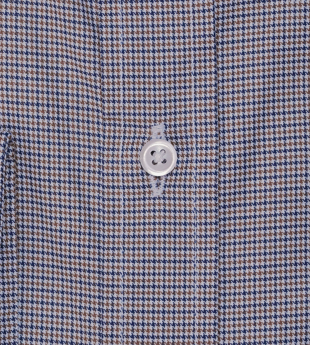 Closeup of men's casual dress shirt in brown houndstooth pattern