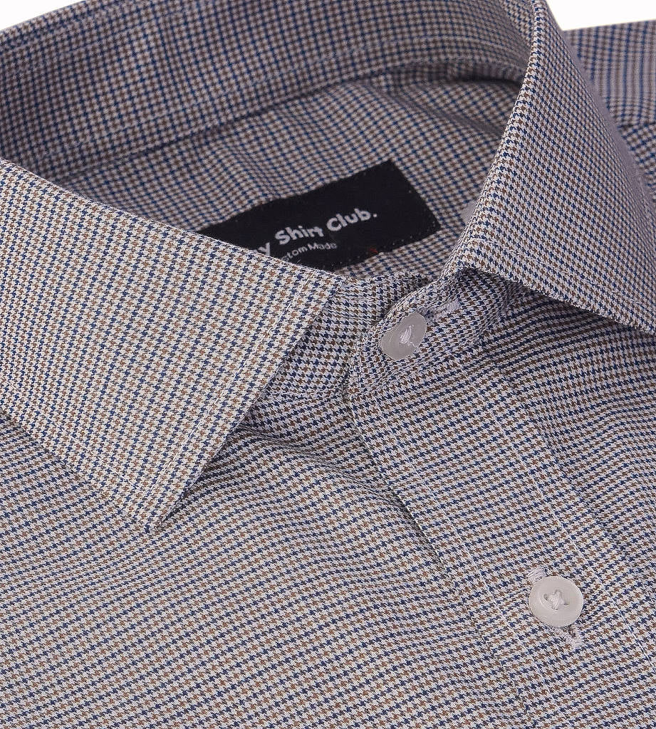 Collar view of men's casual dress shirt in brown houndstooth pattern