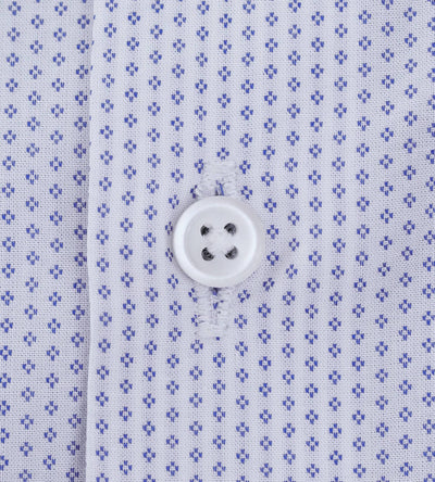 Closeup of placket of men's dobby white casual shirt with blue pattern