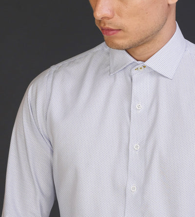 Closeup portrait of man in dobby white casual shirt with blue pattern