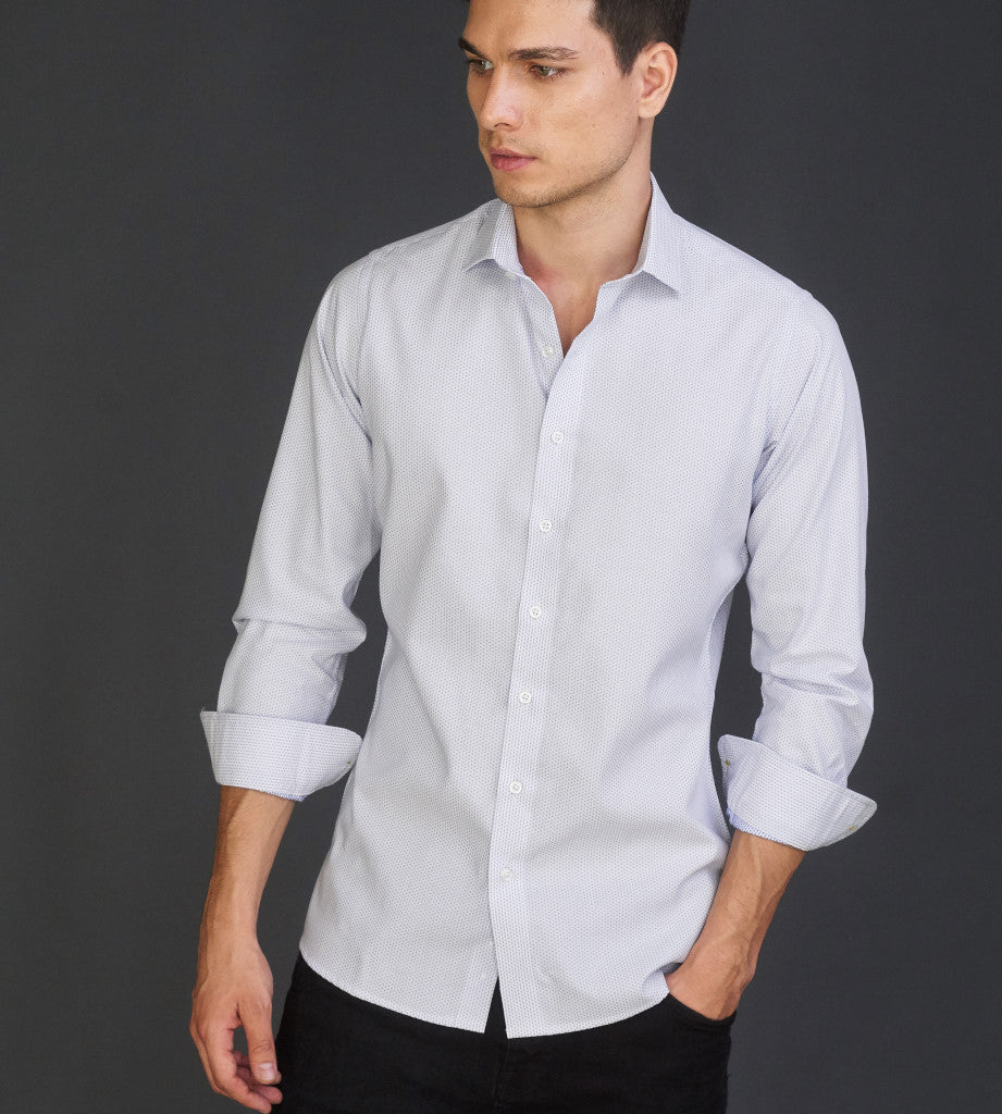 Full body portrait of man in dobby white casual shirt with blue pattern