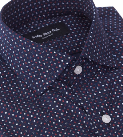 Collar closeup of men's black casual button up shirt with red club pattern