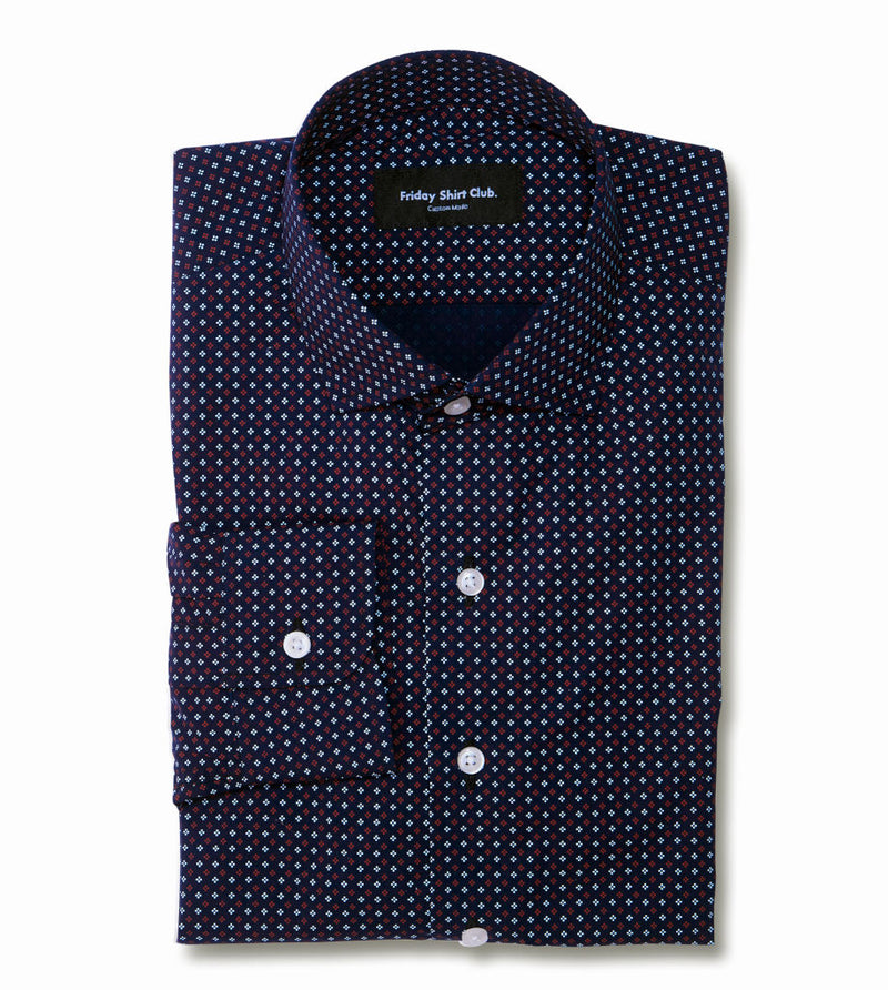 Flatlay of men's black casual button up shirt with red club pattern