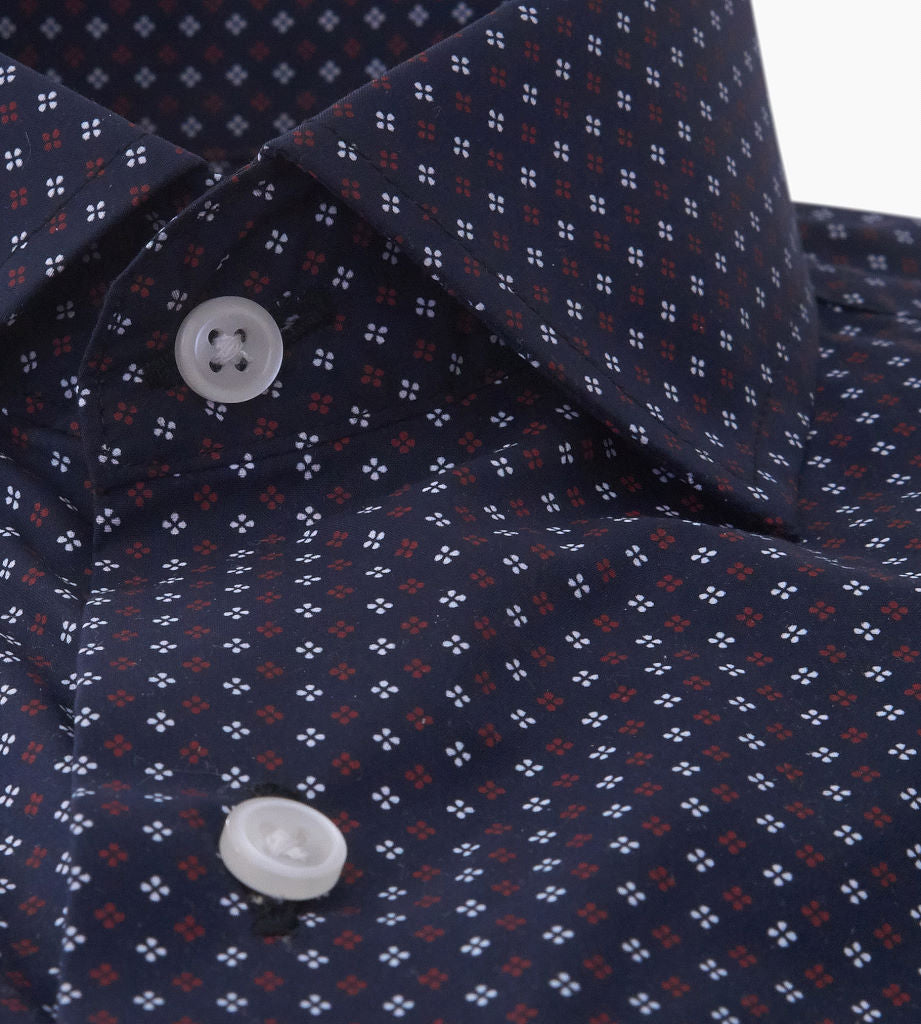 Placket closeup of men's black casual button up shirt with red club pattern