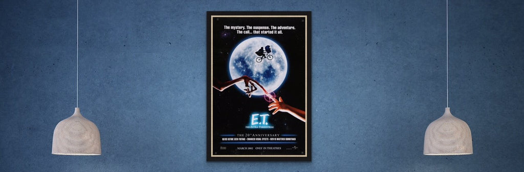 A framed movie poster for E.T. The Extra Terrestrial