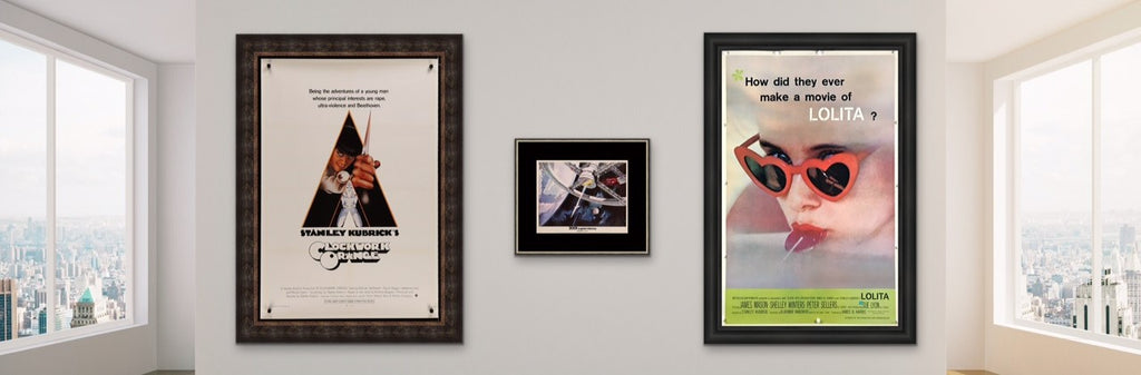 A picture of three movie posters for Stanley Kubrick films in a stylish setting.