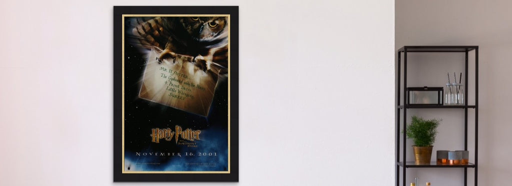 A framed movie poster for Harry Potter and the Philosopher's / Sorcerer's Stone