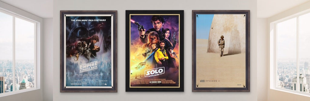 A photo of three Star Wars movie / film posters in a stylish room