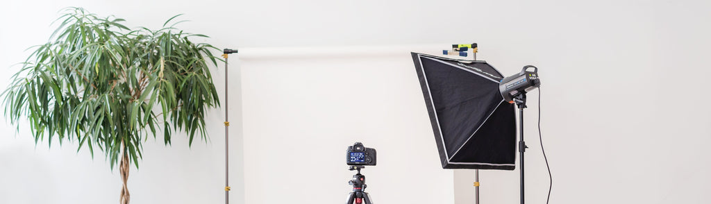 A photo of a camera and light box set up to film