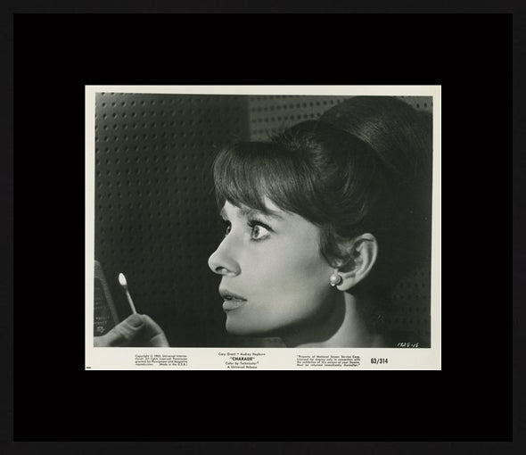 An original movie still from the film Charade starring Audrey Hepburn