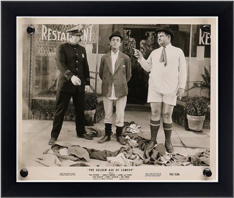 An original movie still for the film The Golden Age of Comedy starring Stand Laurel and Oliver Hardy