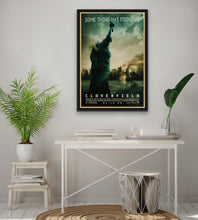 Load image into Gallery viewer, An original movie poster for the film Cloverfield