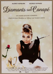 An original movie poster for the Audrey Hepburn film Breakfast at Tiffany's