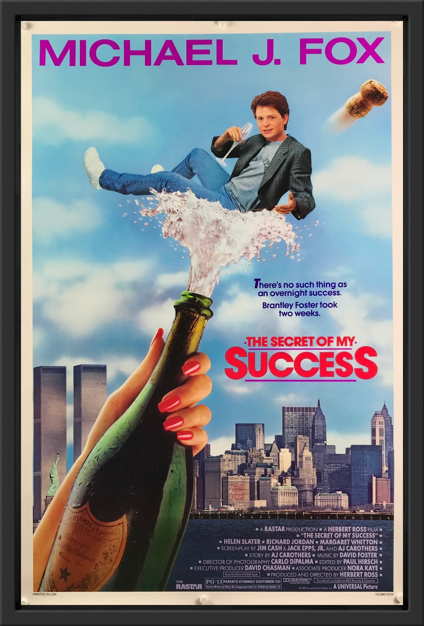 An original movie poster for the Michael J. Fox film The Secret of My Success
