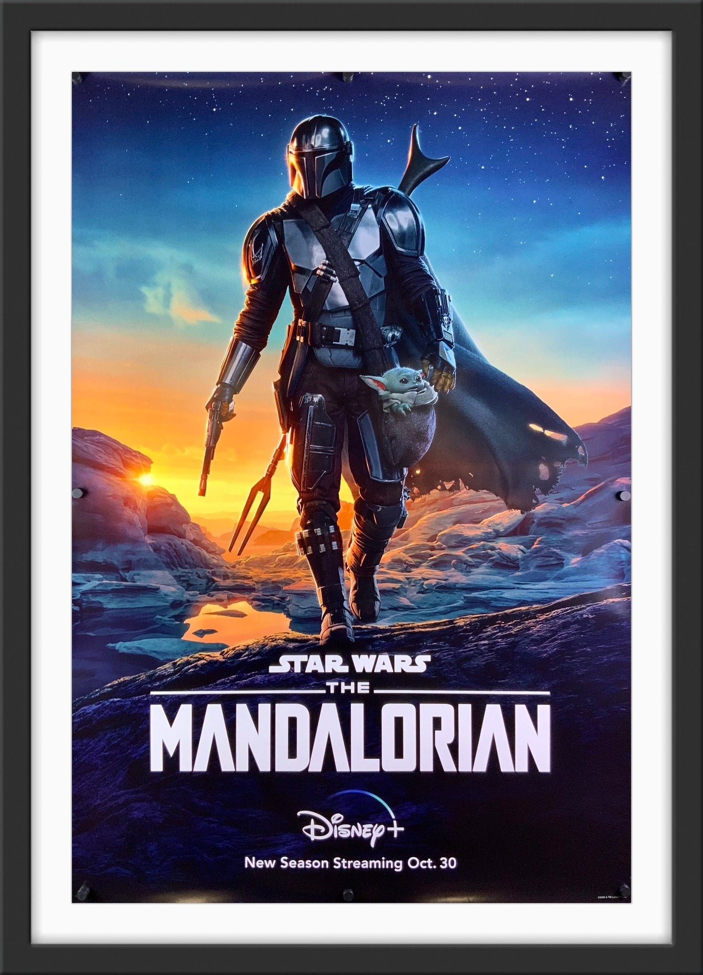 An original movie poster for the Disney+ Star Wars series The Mandalorian