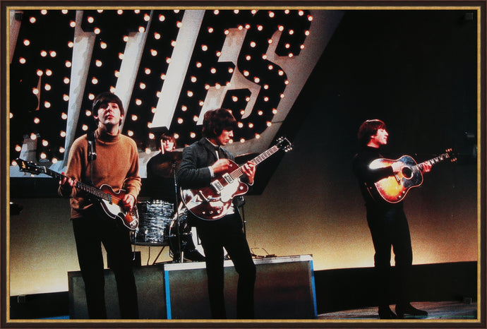 An original license poster of The Beatles